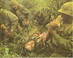 Marines hauling a casualty during the Ghost Patrol. Photo courtesy of Robert Ellison/Blackstar