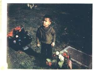 Guest blogger Ron Reyes at a young age, at his father's grave. Photo courtesy of Ron Reyes.