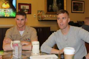At The Hawk. Captain Joe Albano, left, and Captain Josh White, right, discuss the Marine Corps. Photo courtesy of Daniel Folz.