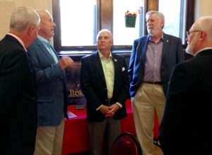 Visiting before the beginning of the ceremony. Left to Right: Lance Thompson; Retired Marine Colonel Gary Randel; Retired Marine Colonel and Director of the Idaho Division of Veteran Services, Dave Brasuell, Former Director of the Boise Office of Veterans Affairs, Jim Vance and Ken Rodgers. Photo courtesy of Betty Rodgers.