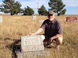 Ken Rodgers at the grave site of A J Pipes in Pleasant Hill, New Mexico. Photo courtesy of Betty Rodgers.